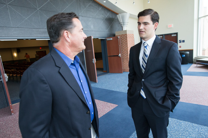 Mike Papale Jr. III right talks with his father Mike Papale Monday during a press conference at the SCSU Adanti Student Center in New Haven Jul. 13, 2015 | Justin Weekes / For the Record-Journal