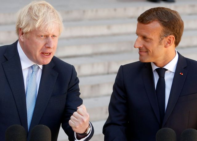 French President Emmanuel Macron, right, and Britain