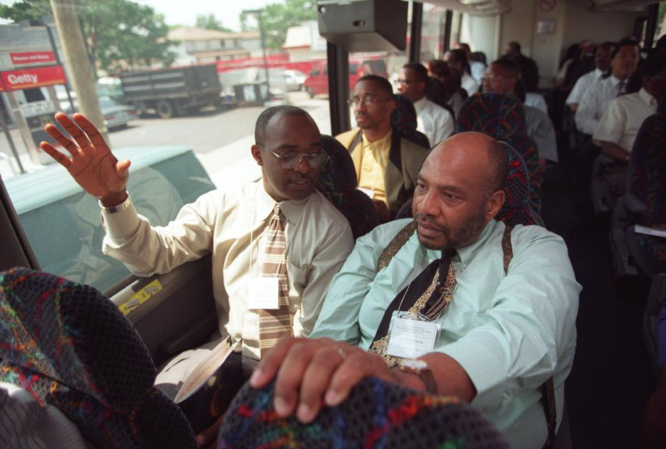 James Walker, left, Associate Minister at Parker A.M.E. Zion Church in Meriden and Benjamin Foster, Director of Wilcox Regional Vo-Tech School in Meriden, talk together on a bus ride to Allen A.M.E. Church in Queens, New York. They participated in a bus trip of Connecticut