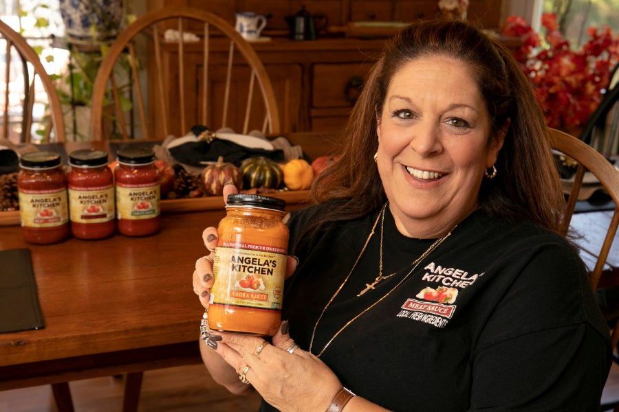 Angela's Kitchen creator Angela Massimino, of Cheshire, holds a jar of Angela's Kitchen vodka sauce.