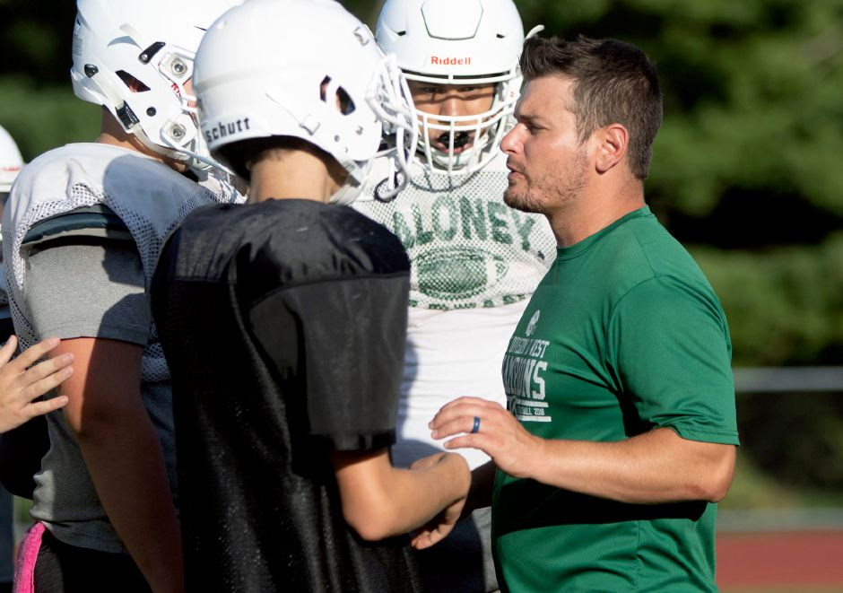 Maloney football coach Kevin Frederick talks with players during football practice on Monday August 26, 2019. Aaron Flaum, Record-Journal
