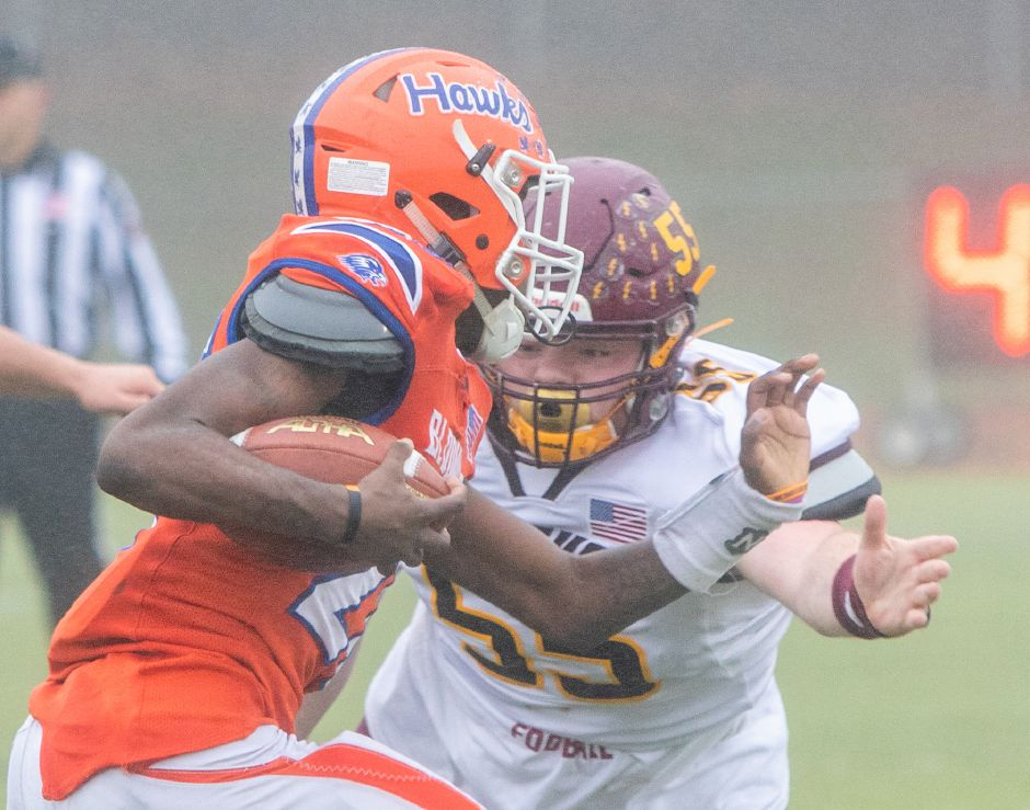 Bloomfield's Shakur Hill gets by Sheehan's Mickey Deming during the CIAC Class S Championship Football game at Trumbull High School. Aaron Flaum, Record-Journal