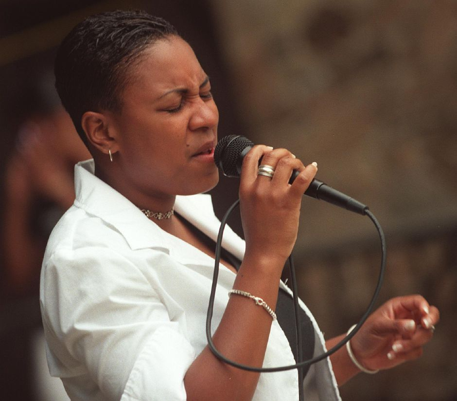 Charmagne Tripp of Manchester Connecticut sings under the bandshell at the Black Expo in Hubbard Park, June 19, 1999.