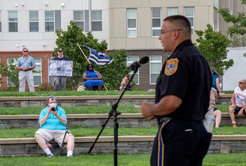 Meriden Police Chief Roberto Rosado speaks at a Sunday, August 9, 2020 rally held on the Meriden Green.| Devin Leith-Yessian/Record-Journal