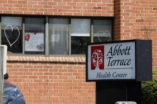 A sign for nursing home employees hangs in a window at the Abbott Terrace Health Center, Thursday, May 14, 2020 in Waterbury, Conn. The coronavirus has had no regard for health care quality or ratings as it has swept through nursing homes around the world, killing efficiently even in highly rated care centers. Preliminary research indicates the numbers of nursing home residents testing positive for the coronavirus and dying from COVID-19 are linked to location and population density —...
