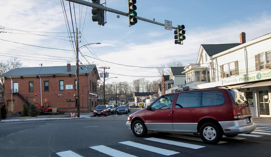 A motorist travels through the intersection of Main Street and West Main Street near the Hop Haus, left, in Southington, Monday, Feb. 12, 2018. Dave Zajac, Record-Journal