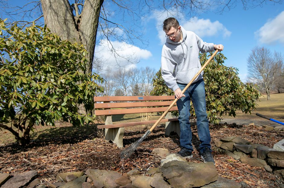Blake Kunst, of Meriden, cleans up a memorial garden he created in honor of his grandfather Carlos Lavado at Hunter Golf Course in Meriden on  Feb. 27. The 19-year-old diagnosed with Autism Spectrum Disorder is a maintenance worker at the course on Westfield Road. Kunst constructed the garden as part of his Eagle Scout project in 2018. Dave Zajac, Record-Journal