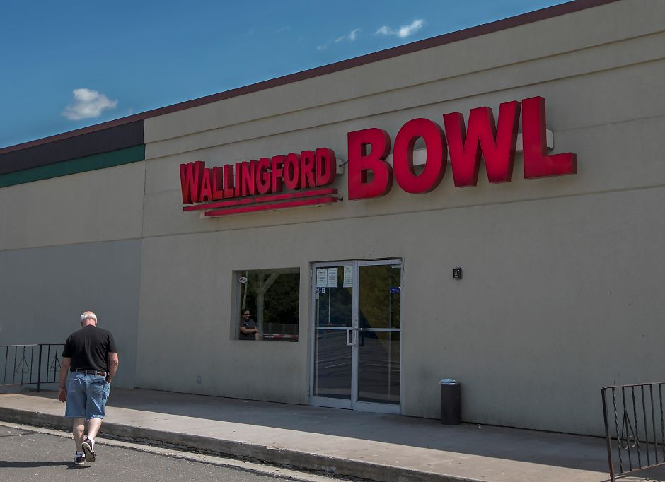 A man walks outside Wallingford Bowl on Route 5 in Wallingford, Wednesday, May 23, 2018. The decades-old bowling alley will close permanently at the end of the month. Dave Zajac, Record-Journal