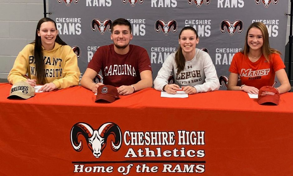 Signing their National Letters of Intent at Cheshire High School on Wednesday were, left to right, swimmers Jililan Stevens (Bryant University), Sam Hanke (South Carolina) and Julia Stevens (Lehigh), and soccer player Caroline Campion (Marist). See more photos online at myrecordjournal.com/sports