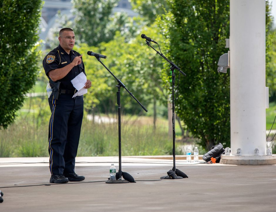 Meriden Police Chief Roberto Rosado speaks at a Sunday, August 9, 2020 rally held on the Meriden Green. During the event, police officers and activists discussed ways to improve policing in the city. Rosado spoke about how seeing officers like Hector Cardona Sr. walking around his neighborhood set him on the path to becoming a police officer.| Devin Leith-Yessian/Record-Journal