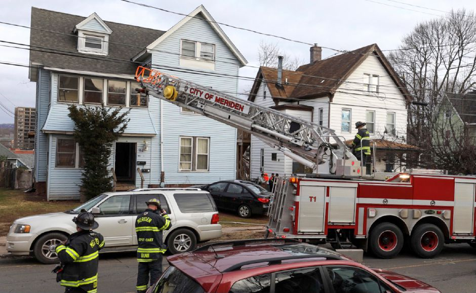 Firefighters at the scene of a fire at 94 Linsley Ave. in Meriden Tuesday Jan. 5, 2021. | Dave Zajac, Record-Journal