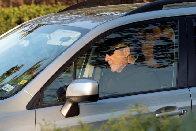 Special counsel Robert Mueller drives away from his Washington home on Wednesday, April 17, 2019. Outstanding questions about the special counsel