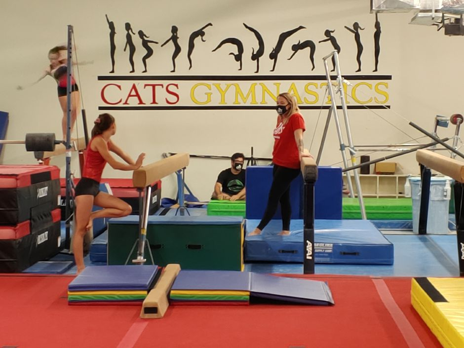 CATS Gymnastics co-owner Lyndsie Norris instructs one of her students on Friday, July 31.