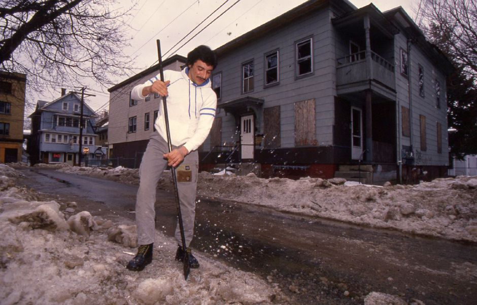 RJ file photo - Confesor Malave breaks up ice on Union Street in Meriden Jan. 24, 1994.