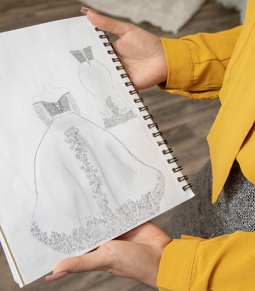 Jacqueline Torres, owner of Jacqueline Bridal Kouture, shows a sketch of a wedding dress she designed at the new business, 314 N. Colony St., Wallingford, Thurs., May 23, 2019. Dave Zajac, Record-Journal