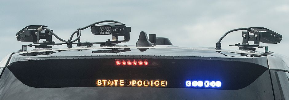 License plate readers mounted on the back of State Trooper Joshua McElroy