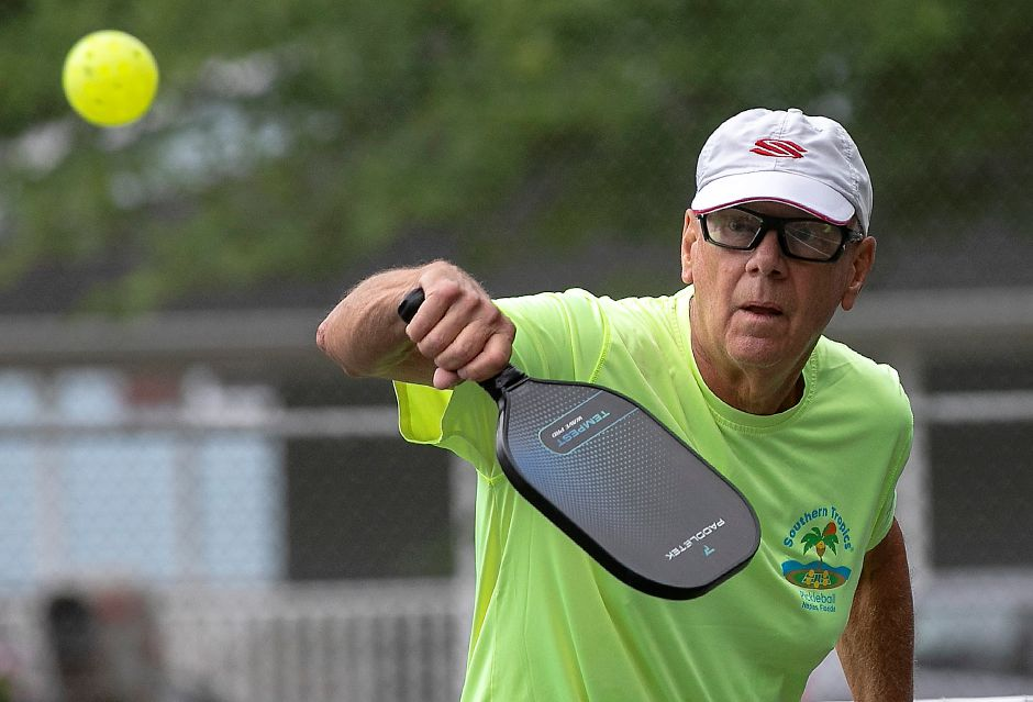 Bob Danielson, of Wallingford, sets up for a backhand during a game of pickleball at Harrison Park in Wallingford, Fri., Jul. 17, 2020. Four tennis courts have been lined for both tennis and pickleball at Harrison Park, but some town leaders and pickleball enthusiasts would like to see dedicated pickleball courts. | Dave Zajac, Record-Journal