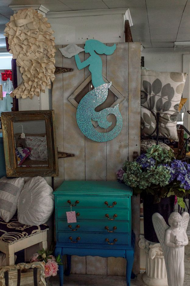 The centerpiece of this display, the blue-to-turqouise gradient side table, was hand-painted by co-owner Paula Charneco of Meriden - at 2 Sister