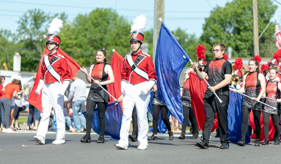 The Berlin High School Marching Band makes its way down Farmington Avenue during the town