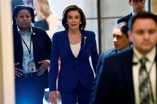 House Speaker Nancy Pelosi of Calif., arrives on Capitol Hill in Washington, Friday, March 27, 2020. (AP Photo/Susan Walsh)