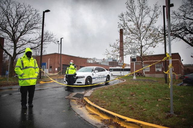 Veterans Affairs Police guard the entrance to a maintenance facility after an apparent steam explosion in a maintenance building at a Veterans Affairs hospital in West Haven, Conn., Friday, Nov. 13, 2020. (AP Photo/Robert Bumsted)