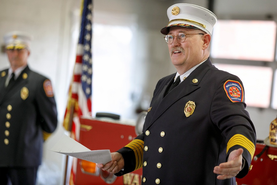 Fire Chief Richard Heidgerd speaks during a ceremony on Friday  honoring him for 40 years of service at Wallingford Fire Headquarters. Deputy Fire Chief Joe Czentnar, left, looks on during the ceremony.