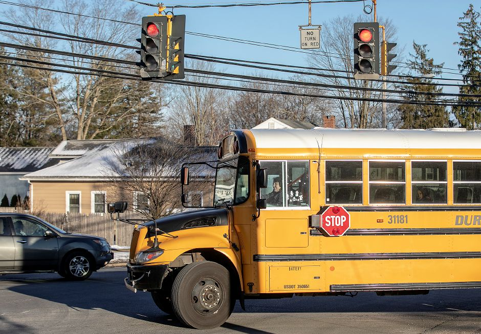 FILE: A bus pulls out of Mary G. Fritz Elementary School in Wallingford at dismissal, Tues., Jan. 21, 2020. Dave Zajac, Record-Journal