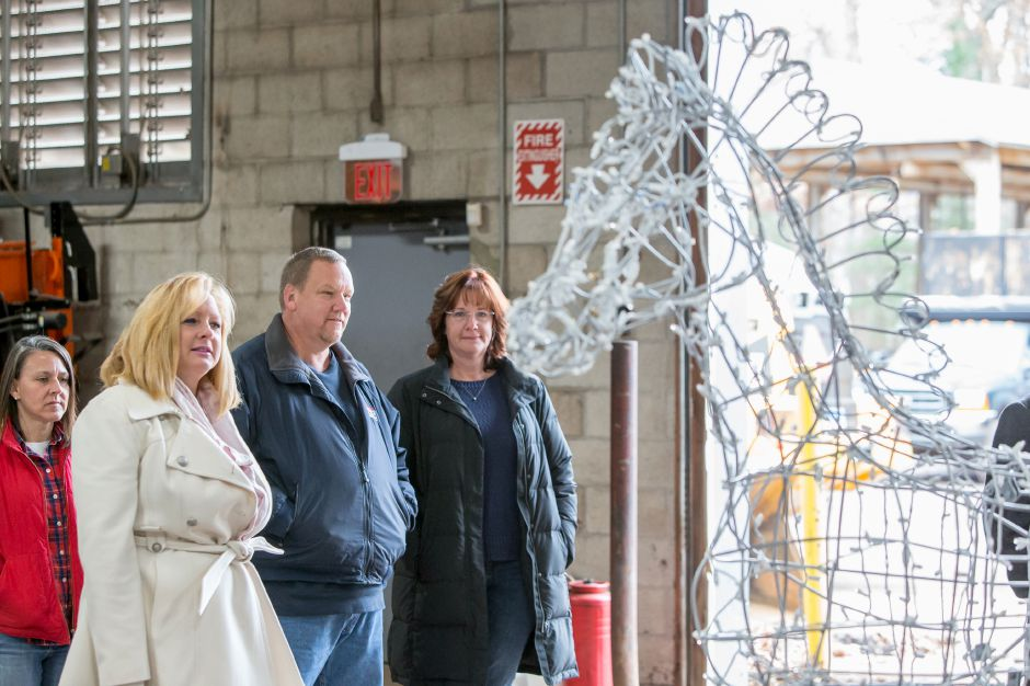 FILE: Dawn Miceli left looks at the assembled horse with Gary and Colleen Saucier who made the donation to purchase the horse Wednesday at the Southington Highway Department Garage in Southington November 21, 2018 | Justin Weekes / Special to the Record-Journal