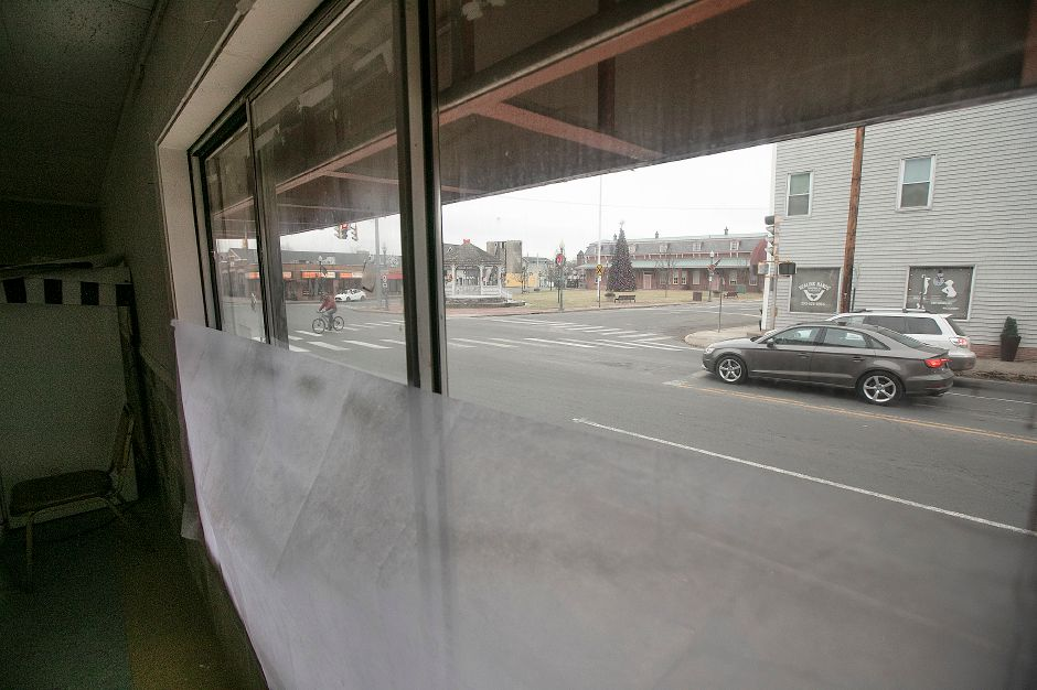 View of North Colony Road from inside a building at 4 Center St. in Wallingford, Thurs., Dec. 26, 2019. The building was recently purchased by a Wallingford couple who plan to fix it up and rent it out, but there are no prospective tenants yet. The building was erected in 1900 and is zoned as mixed residential and commercial use. Dave Zajac, Record-Journal