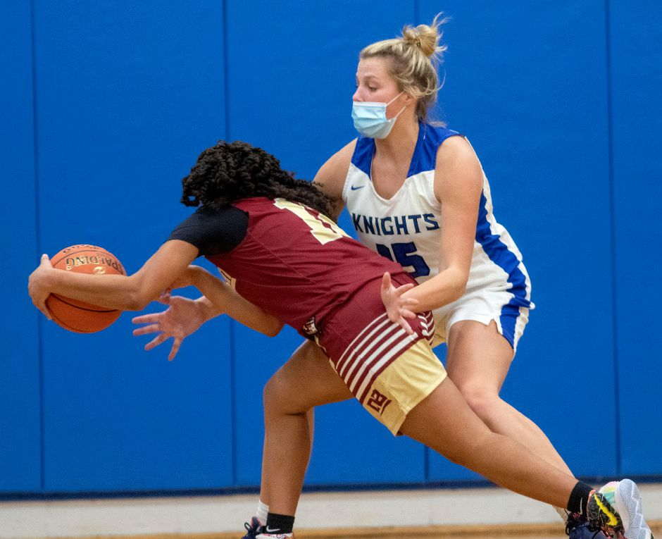 Southington's Allison Carr tries to stop New Britain's Adrianna Faienza form making a pass during the first half at Southington High School on Wednesday, Feb. 10, 2021. Aaron Flaum, Record-Journal