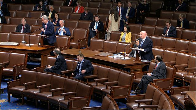 In this image from video, Rep. Kevin McCarthy, R-Texas, left, and Rep. Kevin Brady, R-Texas, stand as they speak on the floor of the House of Representatives at the U.S. Capitol in Washington, Friday, March 27, 2020. (House Television via AP)