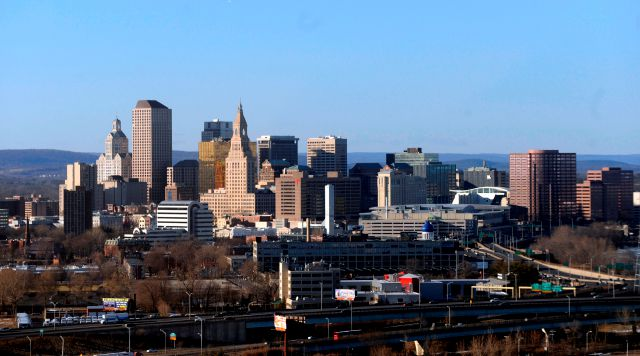 FILE - In this Feb. 7, 2010 aerial file photo, the skyline of Hartford, Conn., rises on the west bank of the Connecticut river. (AP Photo/Jessica Hill, File)