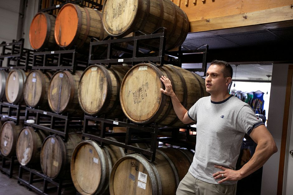 FILE PHOTO – Miguel Galarraga, of Hamden, co-owner of New England Cider Company, talks about the business located at 110 N. Plains Industrial Rd. in Wallingford, Wed., July 17, 2019. The business is seeking to expand in its current space. Dave Zajac, Record-Journal