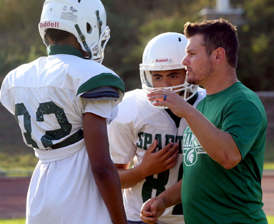 Maloney High School football coach Kevin Frederick talks with players during Monday's practice. Aaron Flaum, Record-Journal