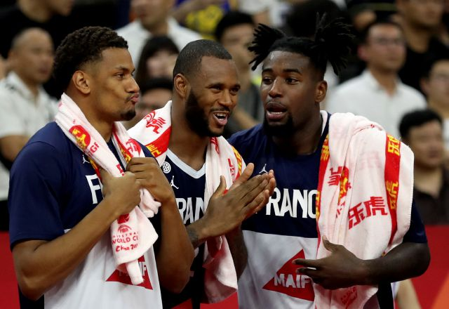 French players react as they near a win over United States during a quarterfinal match for the FIBA Basketball World Cup in Dongguan in southern China