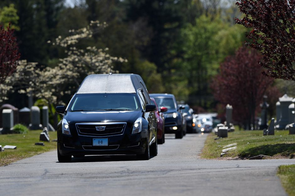 A hearse leads a funeral procession for Hazel Bailey to her burial service at Mountain View Cemetery in Bloomfield Thursday, May 14, 2020. Bailey died of COVID-19 on April 19 at age 73. Her daughter, Francene Bailey, who works as a certified nurses aid at Kimberly Hall North nursing home, the site of several infected patients and deaths from COVID-19, tested positive for the virus in late March. Although Francene Bailey recovered, she's convinced that she unwittingly infected her mother. | Cloe Poisson.