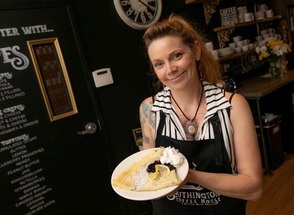 Manager Lilly Fellows holds an order of lemon blueberry crepes at the new Southington Coffee House, 51 N. Main St. in Southington, Thurs., Aug. 15, 2019. Dave Zajac, Record-Journal