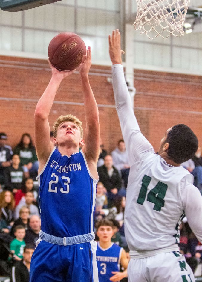 Dylan Olson and the Southington Blue Knights bounced back from their overtime loss to New Britain in Wednesday's season opener with a 49-37 victory on Friday night over Plainville. Aaron Flaum, Record-Journal