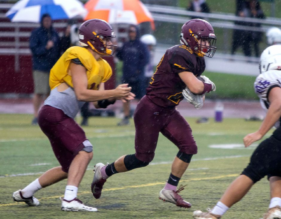Russel Rutkowski turned this handoff from quarterback Kyle Simmons into a touchdown during Friday's scrimmage against North Branford. Rutkowski, a senior, will be a two-way Sheehan staple as H-back and linebacker. | Aaron Flaum, Record-Journal