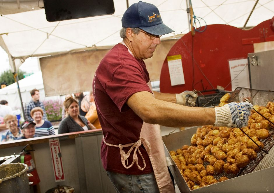 Glenn Benoit, of Southington, racks up another batch of apple fritters at Zion Lutheran Church
