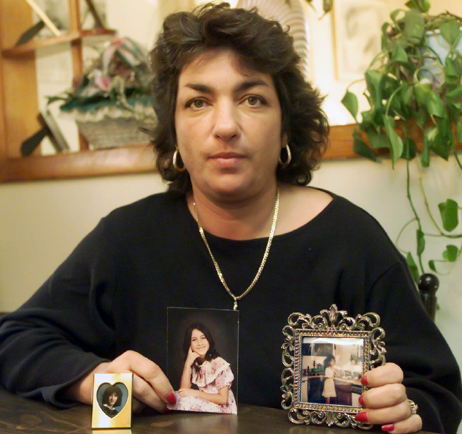 Donna Jones in her Waterbury home Wed., March 28, 2001 with photos of her daughter Doreen Vincent, who has been missing since 1988.