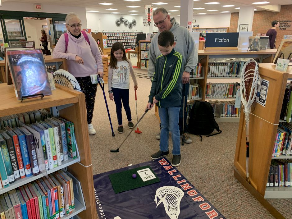 Vito Raso gets ready to tee off at Wallingford Public Library
