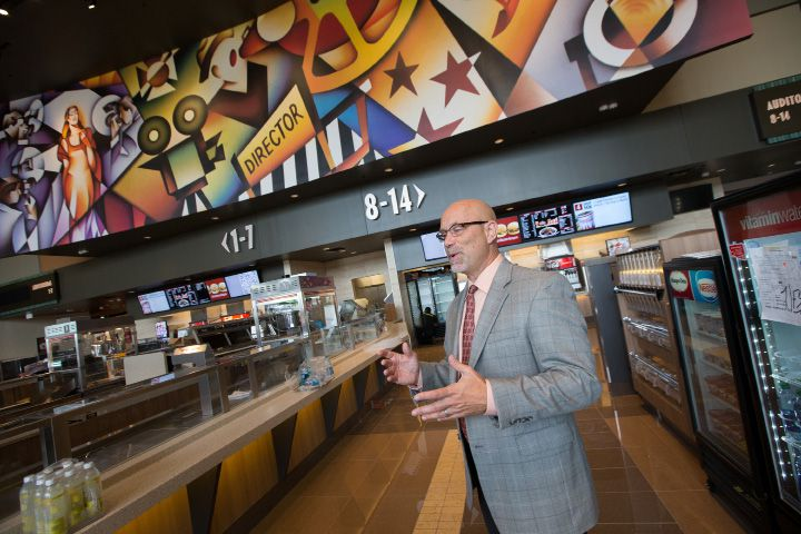 In this 2015 file photo, Bryan Jeffries, marketing director for Cinemark, explains the cafe-style concessions area in the main lobby at Cinemark Theaters in North Haven. With COVID-19 hospitalization rates stabilizing in the state, Connecticut movie theaters are now allowed to reopen their concession stands.