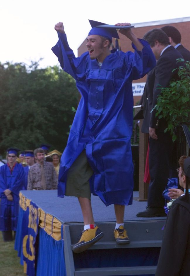 Jeremy Vega jumps and cheers after receiving his diploma at Wilcox Fri., June 18, 1999. He was in the Industrial Electronics class.