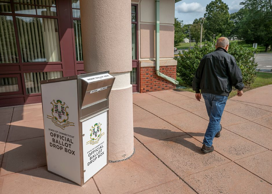 A man walks past an official ballot drop box placed in front of the Wallingford Senior Center, Wed., Sept. 16, 2020. Dave Zajac, Record-Journal