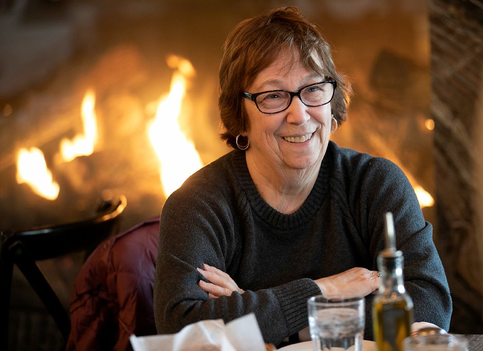 Roz Katz, of Wallingford, enjoys lunch in front of a new fireplace at Viron Rondo Osteria, 1721 Highland Ave., Cheshire, Nov. 13, 2019. The restaurant has undergone a $7 million expansion. Dave Zajac, Record-Journal