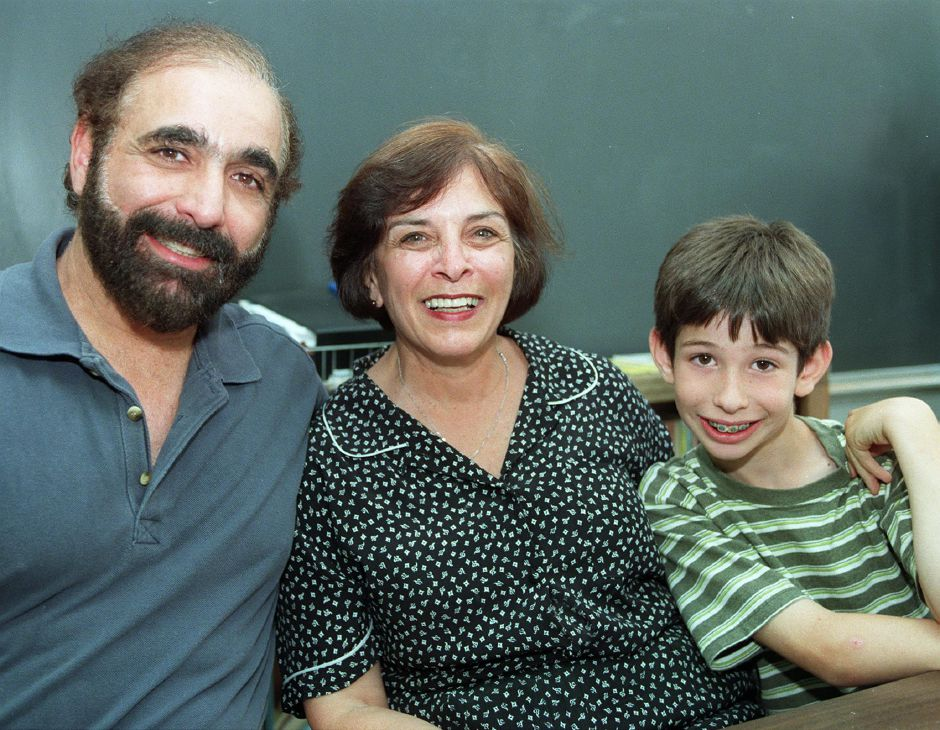 RJ file photo - Michael Berwick, left, was one of the 1st students that Norton School teacher Fran Bontatibus taught, and his son Ethan Berwick, 9, right, will be one of her last as she retires after this school year June 18, 1999.