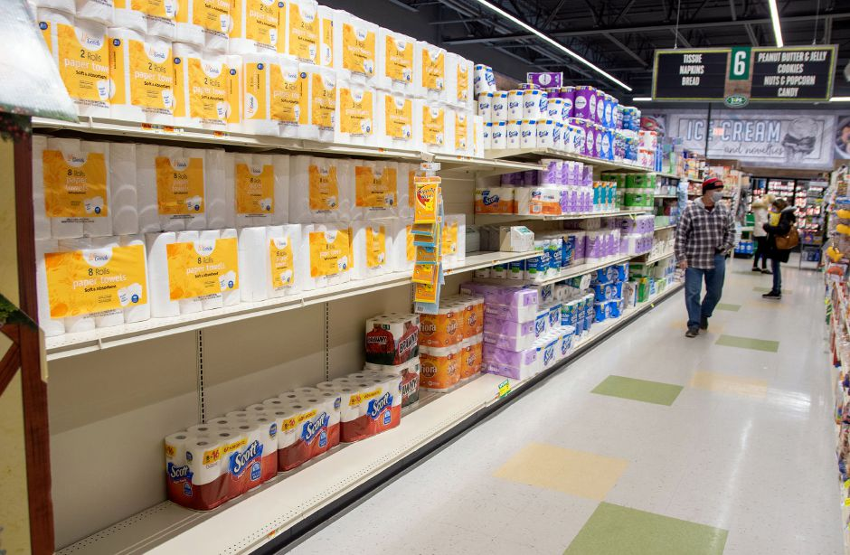 A customer walks by the toilet paper in stock at the Tops Marketplace in Southington on Tuesday. Aaron Flaum, Record-Journal