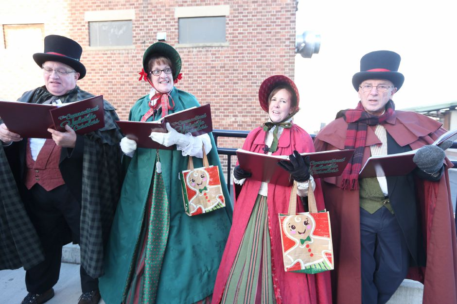 The Connecticut Yuletide Carolers sing to welcome Santa as he arrives at the Meriden train station during the annual Yulefest on Saturday, Nov. 30, 2019. Emily J. Tilley, special to the Record-Journal.