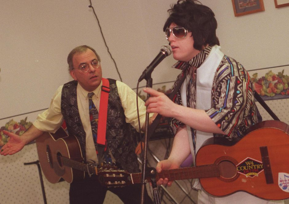 "John DeMasi, left, sings with Chris Burke , the young actor with Down Syndrome who played ""Corky"" on the television series ""Life Goes On."" Burke visited and entertained at High Road Student Learning Center in Wallingford April 4, 2000. DeMasi is a professional musician and lifelone friend of Burke."